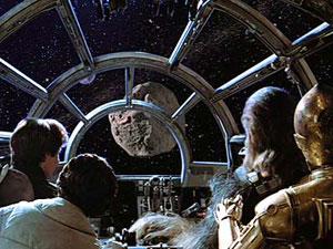 El Halcón Milenario acercándose a un asteroide